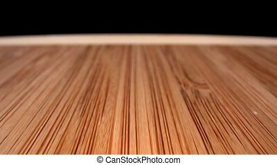 Bamboo cutting board extreme closeup dolly from back to...