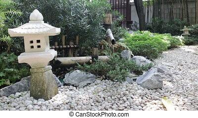 Bamboo flowing water decorated in zen garden, stock footage