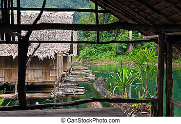 Bamboo huts floating in a Thai village
