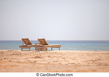 Bamboo loungers on the beach