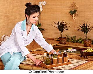 Bamboo massage at spa.