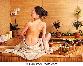 Bamboo massage at spa .