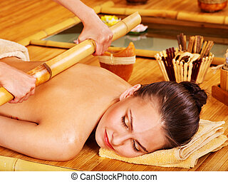 Bamboo massage. - Young woman getting bamboo massage.