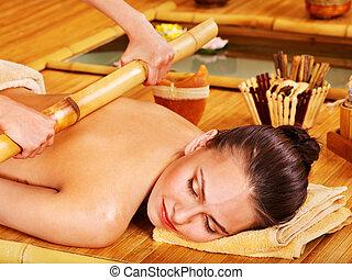 Bamboo massage. - Young woman getting bamboo massage.