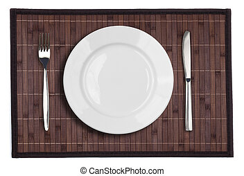 Bamboo placemat with plate fork and knife isolated on white