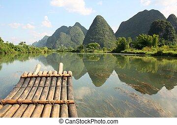 Bamboo rafting on Li-river, Yangsho - Bamboo raft on the...