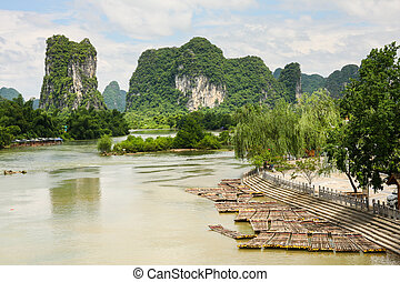 Bamboo rafts in idyllic li river scenery yangshuo china