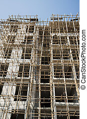 bamboo scaffolding in structure building on blue sky