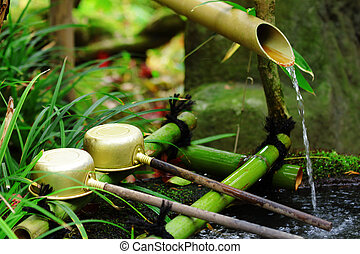 Bamboo water fountain with ladle in Japanese temple