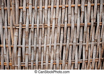 Bamboo weave pattern on fence of vernacular architecture in...