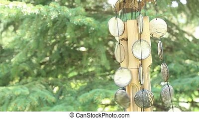 bamboo wind chime - bamboo and shell wind chime blowing in...