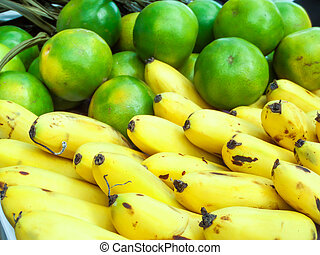 banana and orange on the basket in market