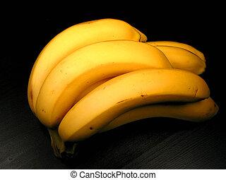 Banana bunch on black - Bunch of yellow bananas on black...