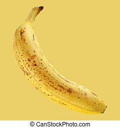 Banana fruit isolated over a yellow background