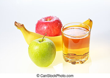 Banana, green and red apples and glass of juice