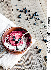 banana ice cream with blueberries and coconut flakes