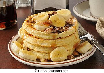 Banana nut waffles - A stack of banana nut waffles with ...