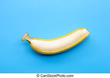 Banana on blue background. Copy space