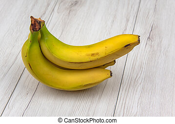 Banana on white wood table, isolated