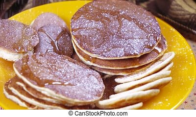 Banana pancakes on a plate - On the decorated table banana...