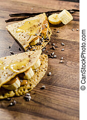 Banana Pancakes With Choco Chips On Table - Closeup of...