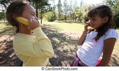 Banana phone - Two girls pretending to talk on the phone...