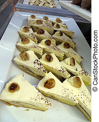 Banana pie - Slices of banana cream pie with banana slice on...