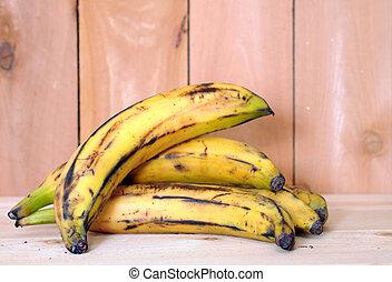 banana plantain - ripe banana plantain on wooden background...