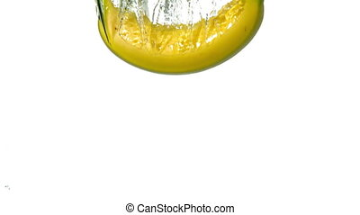 Banana plunging into water on white background in slow...