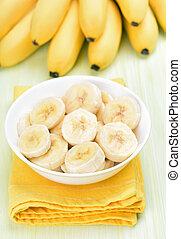Banana slices in white bowl