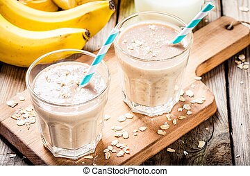 Healthy breakfast: banana smoothie with oatmeal, peanut butter and milk