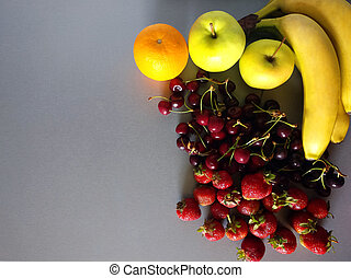 Banana, strawberry, cherry, orange And apple on a gray background