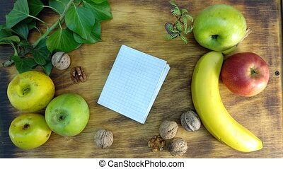 bananas and apples on the cutting board. 4K.