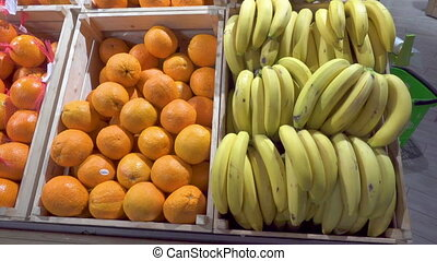 Bananas and oranges in a supermarket.