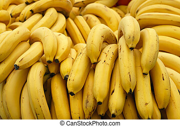 Bunch of yellow ripe bananas at market