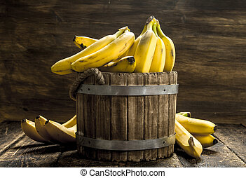 Bananas in a wooden bucket.
