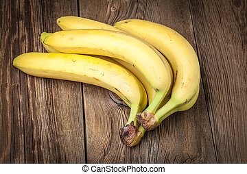 Bananas on a wooden background.