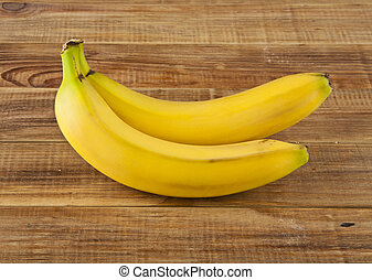 bananas on a wooden background