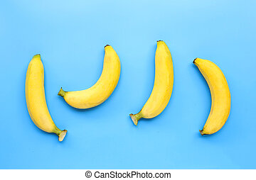 Bananas on blue background. Top view