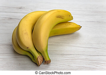 Bananas on white wood table, isolated