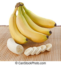 bananas slices - bunch of bananas and slices on a wooden set...