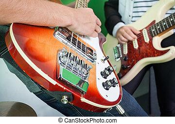 Band Members Playing Guitars In Recording Studio