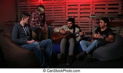 Band performing music unplugged in club