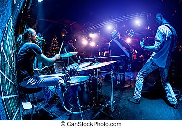 Band performs on stage