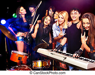 Band playing musical instrument. - Musical group male and...