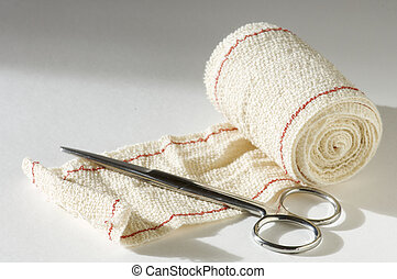 bandage and scissors