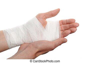 bandage on a hand - white medicine bandage on injury hand on...