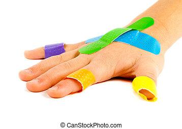 Bandage-on-child-hand - Colorful bandages on child's hand.