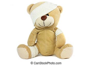 teddy bear with bandaged head on white background
