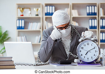 Bandaged businessman worker working in the office doing paperwor